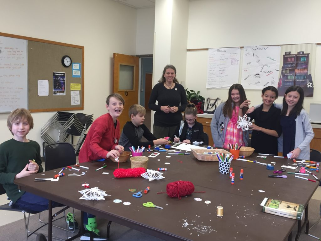 Church youth working on a craft project around a large table