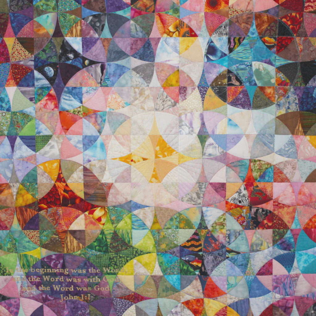 multicolored quilt with circle patterns
