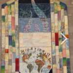 multicolored quilt with an image of the earth representing communication between people and God