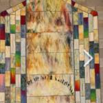 multicolored quilt with an image of the earth representing communcation with God