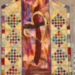 multicolored quilt with geometric shapes representing the Cross