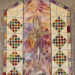 multicolored quilt in pastel colors representing the Cross