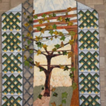 quilt with a tree image representing nature and growth